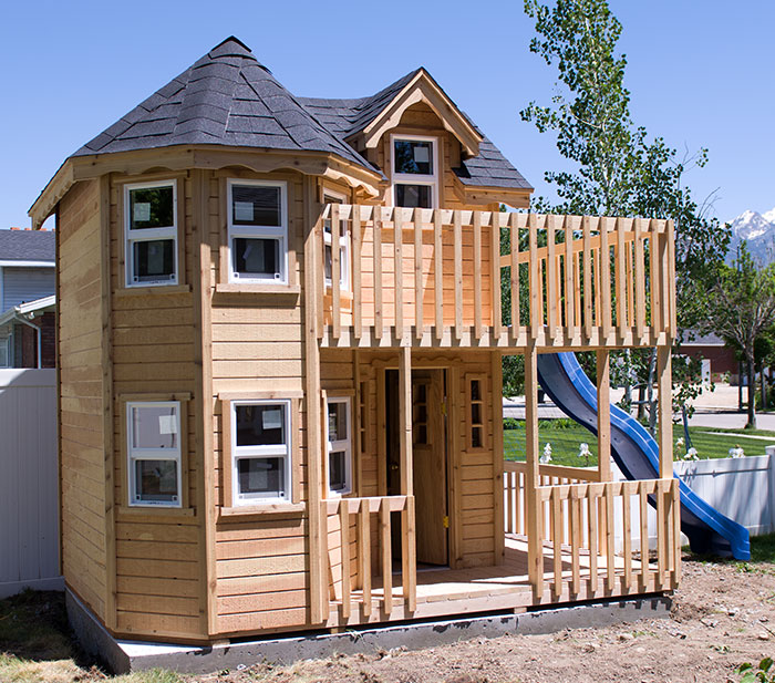 wood playhouse with deck and turret